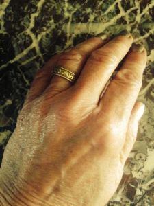 Why do I wear my husband's wedding ring?